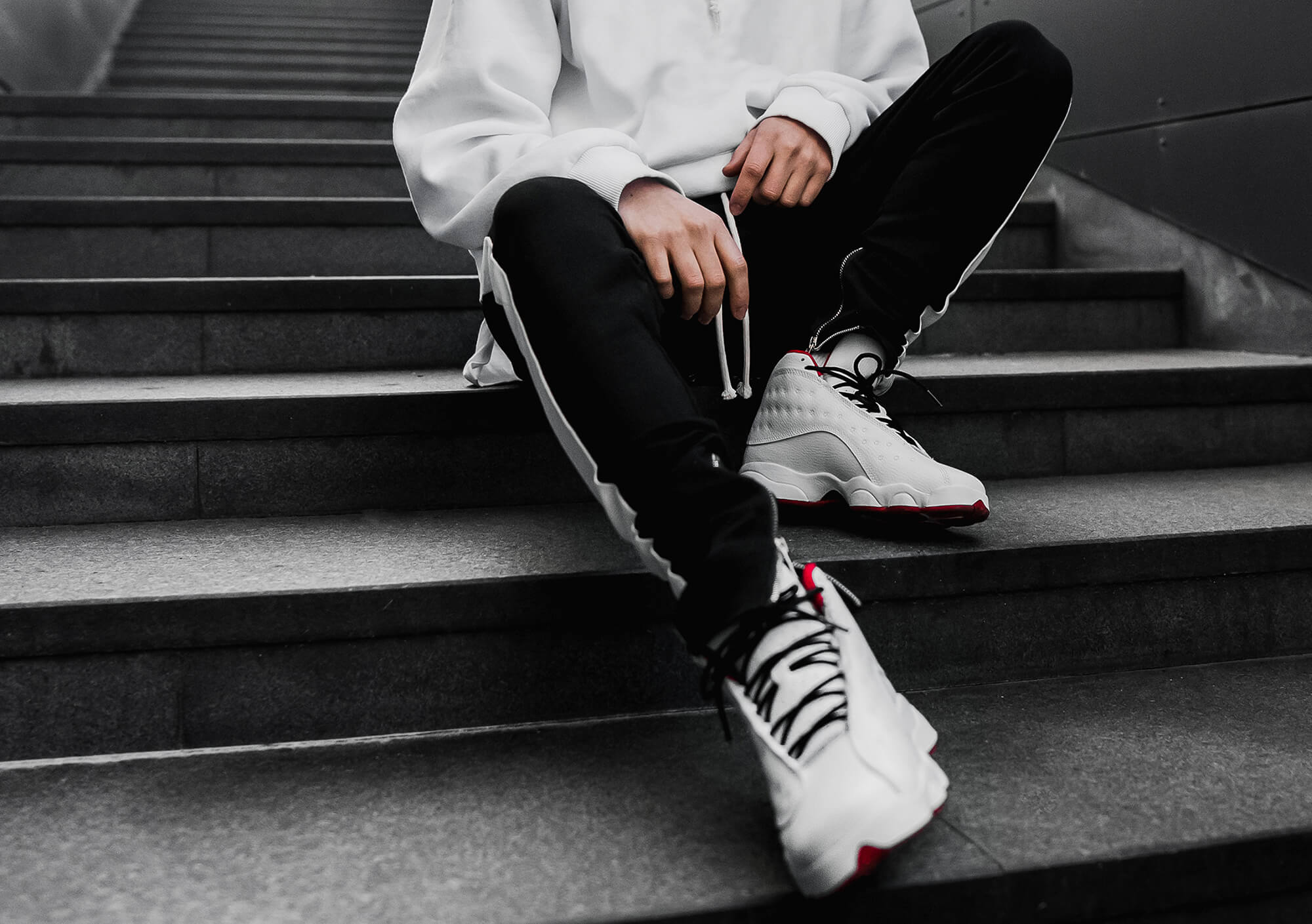 Man on stairs wearing traininers