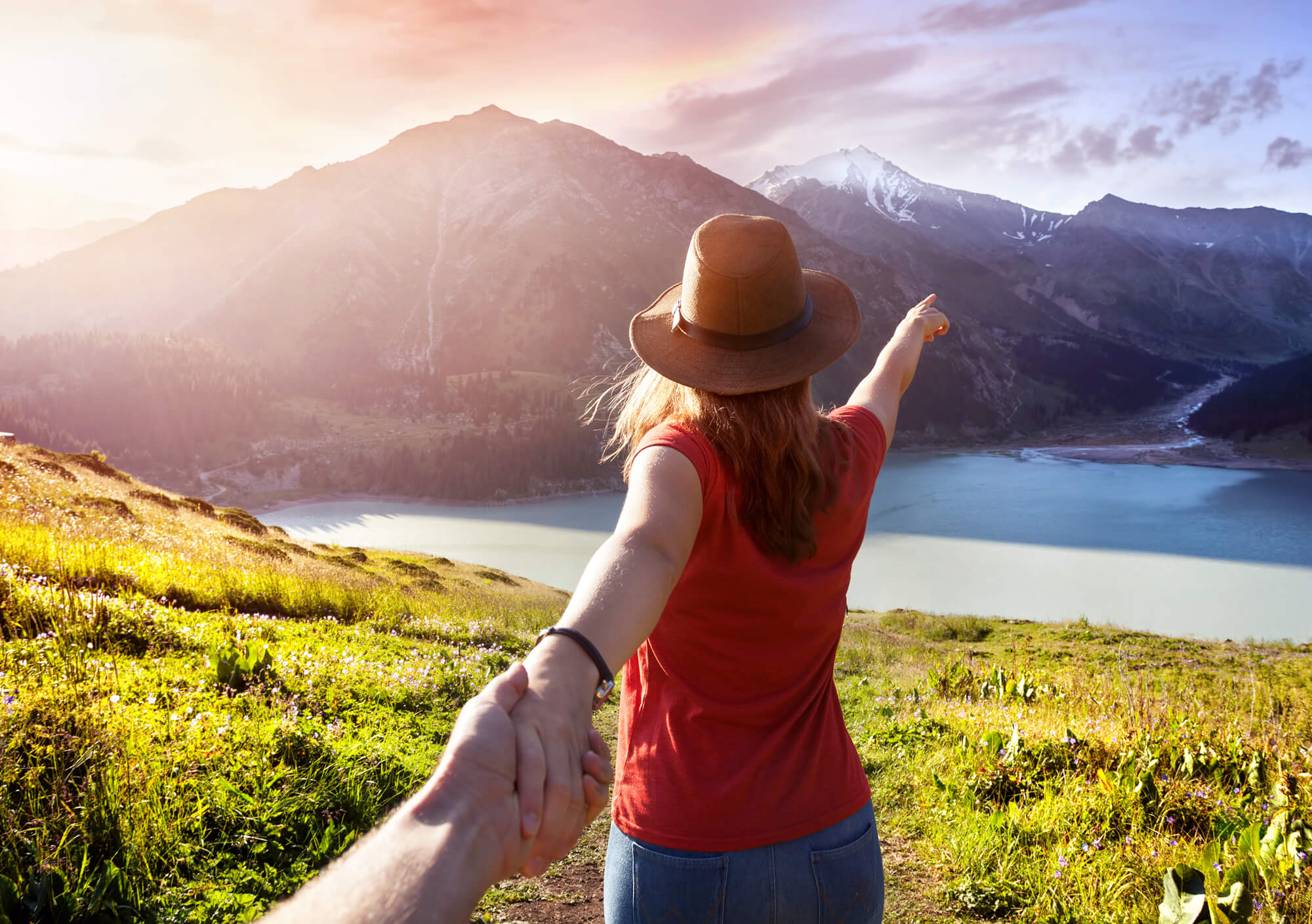 Women pointing to mountains