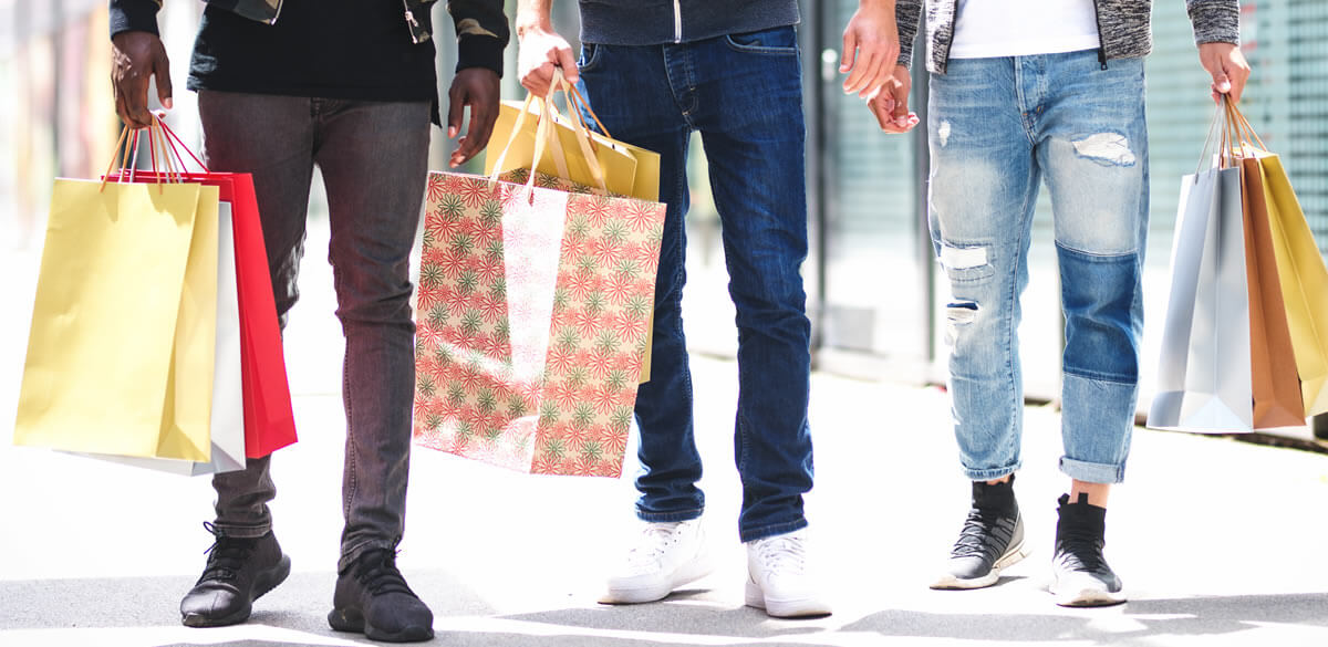 Group of men shopping on the high-street