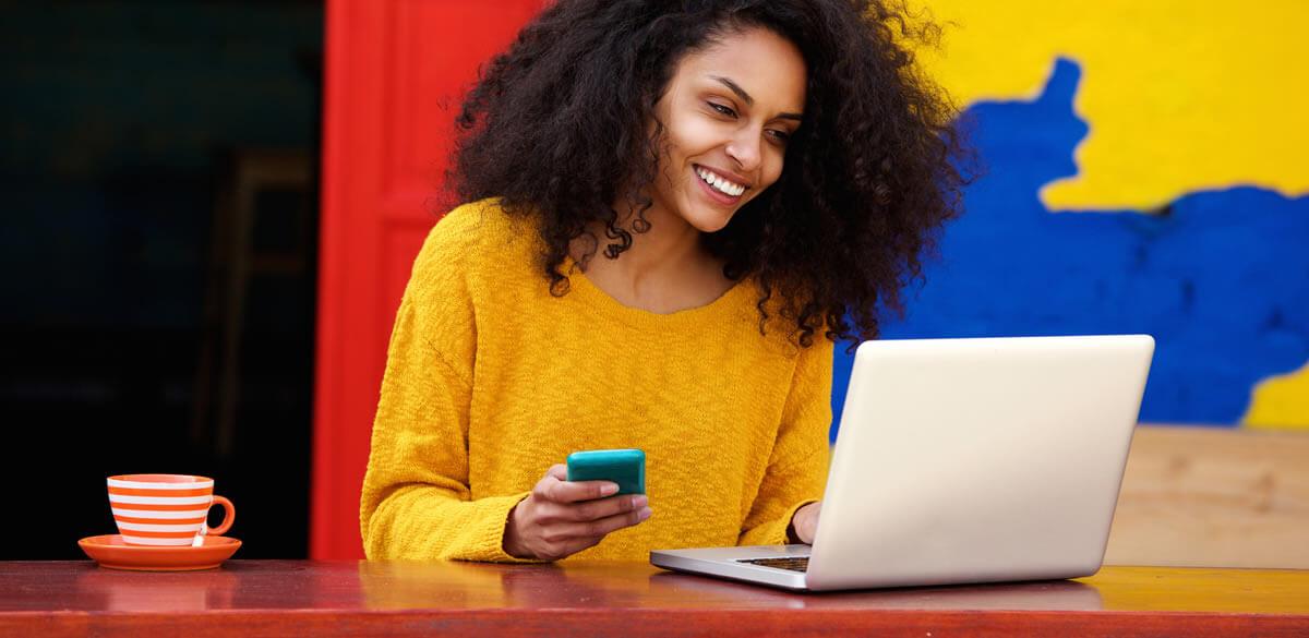 Women making a purchase on a laptop