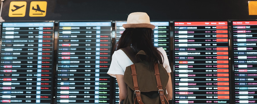 Airport traveller looking at cancelation board