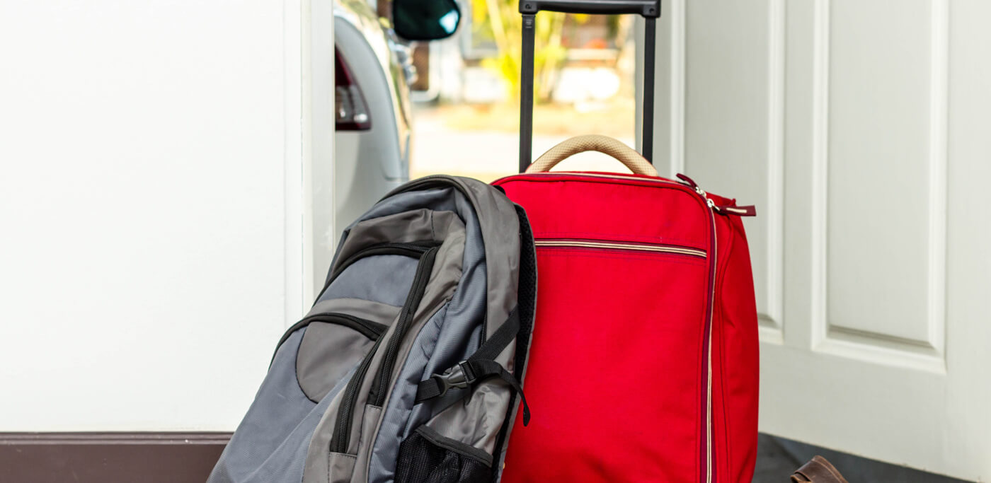 Bags packed by the door