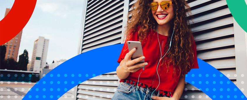Trendy women reading on mobile phone