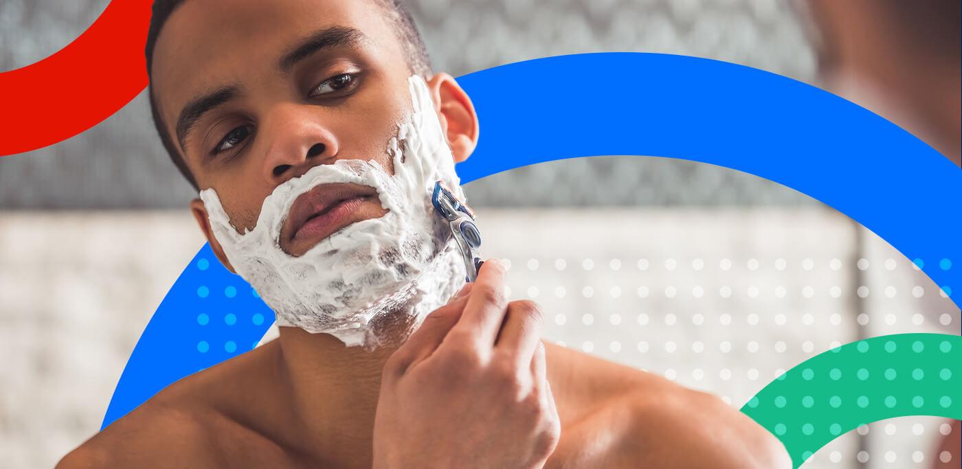 Man shaving in the mirror