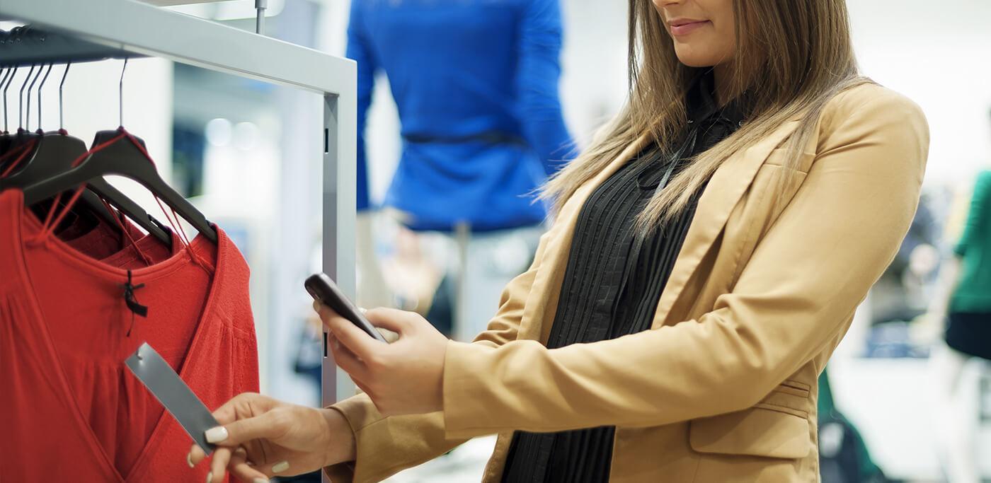 Shopper using phone to compare price