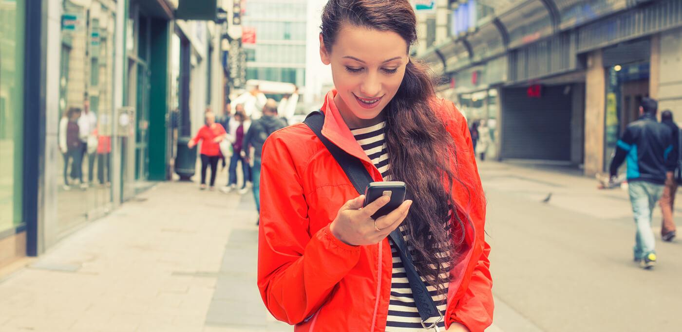 women in street on phone