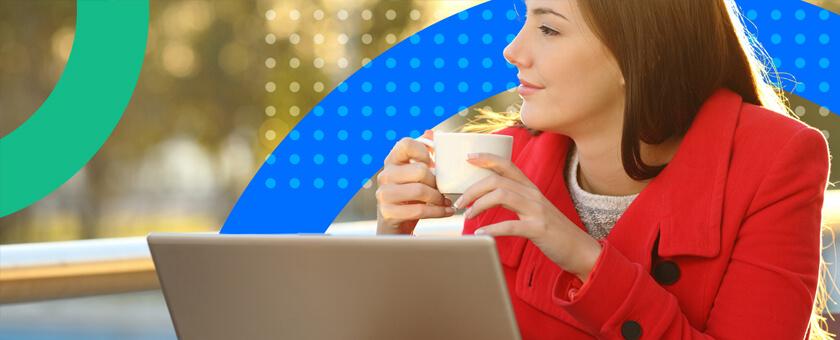 Loyal customer on laptop drinking coffee